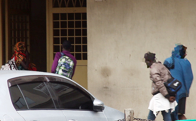 oung arimojong girls being led inton a building in airobi redit ounter uman rafficking rustast frica