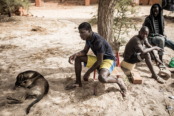 omeless young men are seen with their dog ion in a quarantined area at a refuge for newly arrived street children outside akar on pril 10 2020