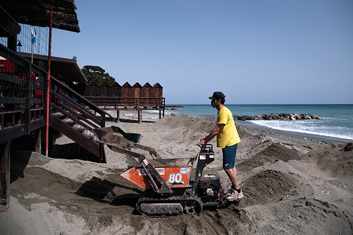 he owner of a bathing facility uses a selfloading mini dumper to set sand on a beach on ay 14 2020 in lbissola arina near avona iguria during the countrys lockdown aimed at curbing the spread of the 19 infection caused by the novel coronavirus hoto by