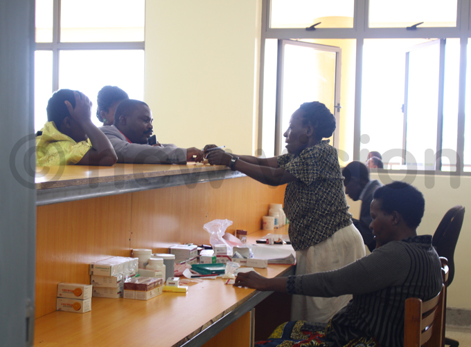 worker dispends drugs to patients at the hospital hoto by acheal assuuna