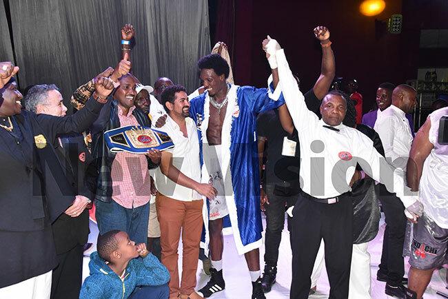 hafik iwanuka celebrates winning the  frican eavyweight hampionship title