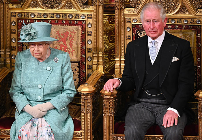 n this file photo taken on ecember 19 2019 ritains rince harles rince of ales sits with ritains ueen lizabeth  on the he overeigns hrone before she delivered the ueens peech in the ouse of ords chamber during the tate pening of arliament in the ouses of arliament in ondon on ecember 19 2019