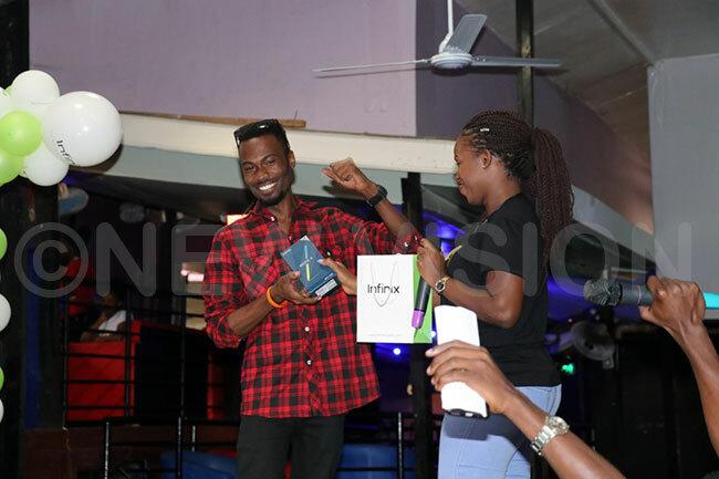 he winner onas ayme receiving the prize