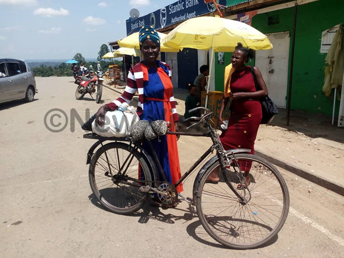 woman uses a bicycle from usunga town council to undibugyo town council a distance of 19 km hoto by eoffrey
