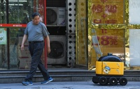 China: Yellow robots deliver snacks to your home