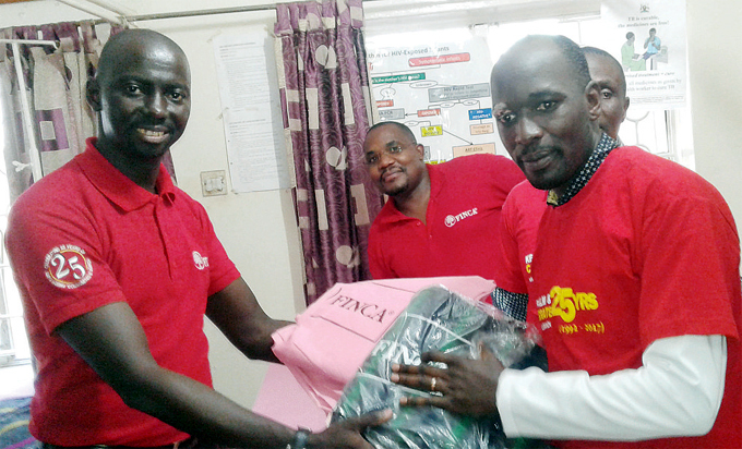 nyutta handing over items to r dward awejje of amwokya hristian aring ommunity as part of the banks corporate social responsibility recently