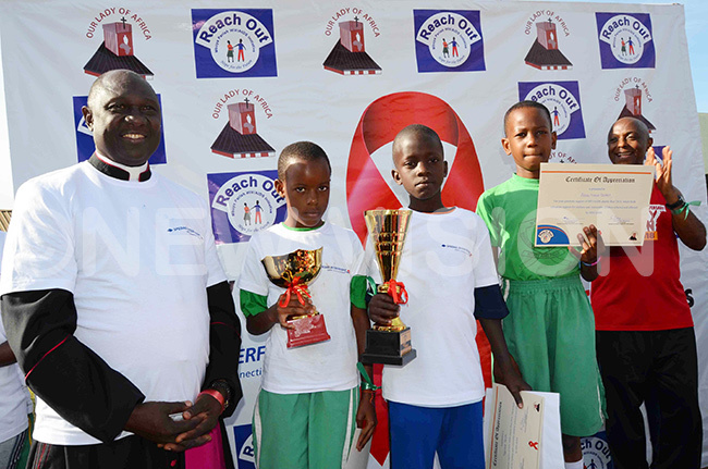 sgr awrence semusu  and r ohn ungereza  with some of the winning children of the charity run