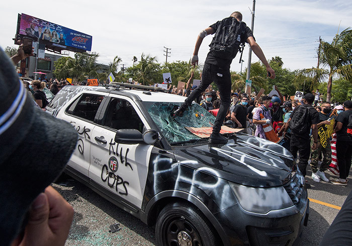 emonstrators smash a police vehicle in the airfax istrict as they protest the death of eorge loyd  in os ngeles alifornia on ay 30 2020  emonstrations are being held across the  after eorge loyd died in police custody on ay 25 hoto by ark