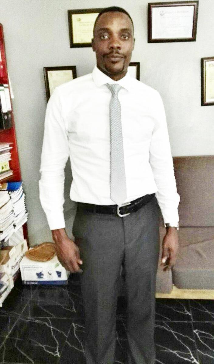 ukenya in his office