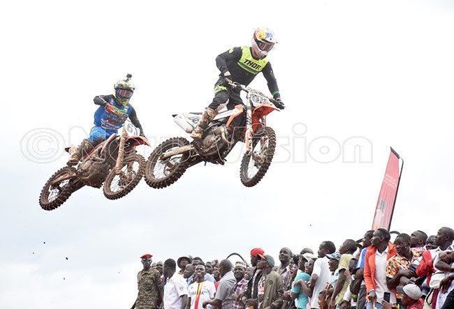 iders at a jump durimng the rmed forces motocross