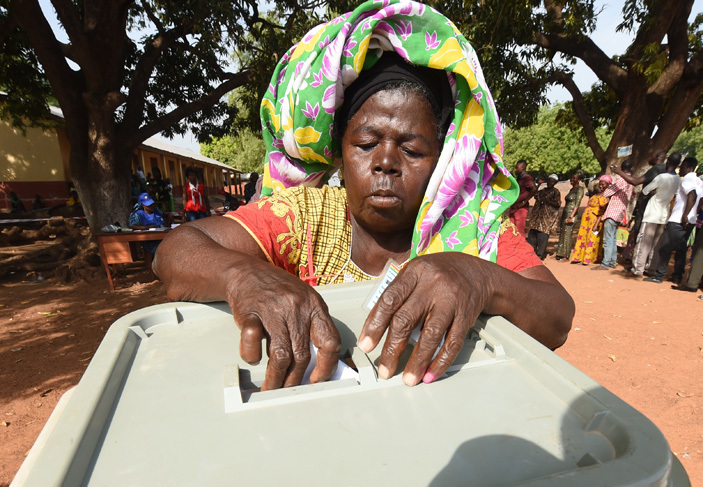 woman votes at a polling booth as people wait in line in the ole district northern region on ecember 7 2016