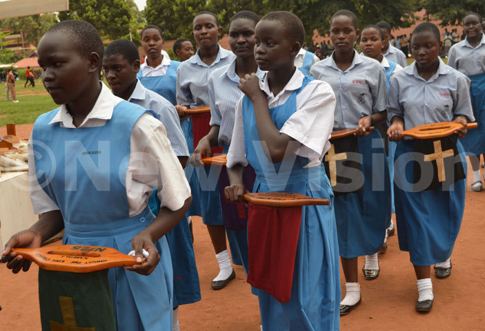 tudents from ur ady ueen of frica irls  ubaga carry offertory