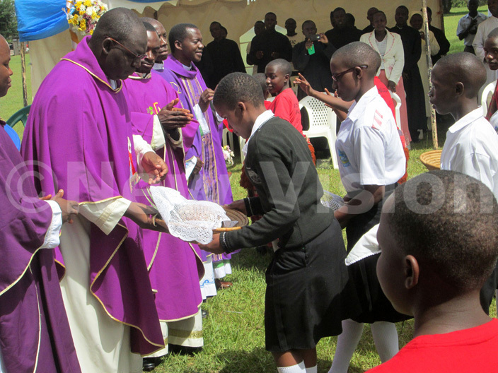 tudents present offertory to clerics during the celebrations