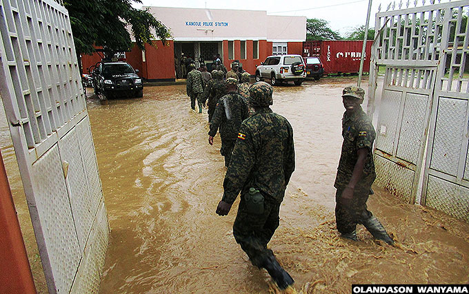 soldies walk through the water to reach submerged  at angole town council hoto by landason anyama