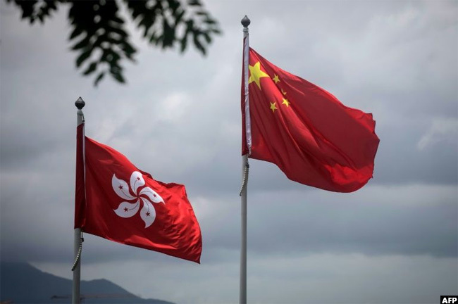 hinas national flag is seen beside the ong ong ensign