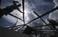 Haitians rebuild as aid effort gains traction