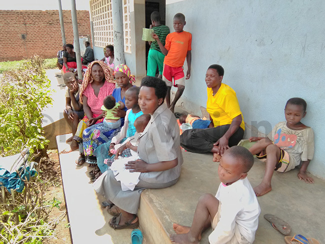 atients seated on the veranda of irembo ealth enter  that will be upgraded to health center  hoto by smael asooha