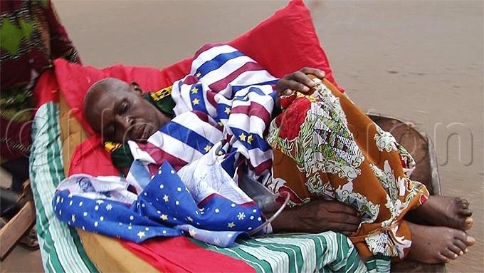 ugangas sickly sister lying  in a wheelbarrowhoto by eginah alunga