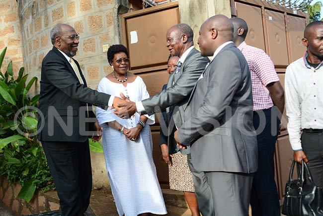 r ugunda being welcomed by isamba ugerwa and ampala minister eti amya at the late rof sibambis residence