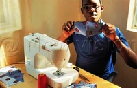 14-year-old earns from making masks