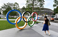 Tokyo weighs scaled-back Olympics, says governor