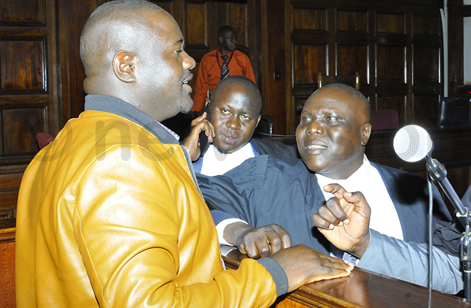 atongole speaks to his lawyers van chieng and aleb laka left hoto by ilfred anya