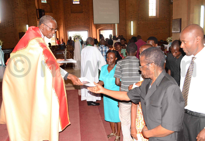 ev an ityo hands out booklets at amirembe athedral hoto by awrence ulondo