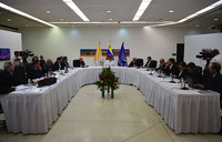 Venezuela govt, mistrustful rivals in crisis talks