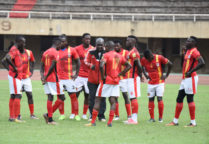nterim coach oses asena passes on instructions to his charges during a training session at amboole tadium hoto by palanyi sentongo