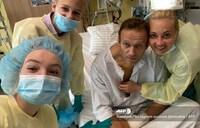 Navalny says 'amazing' to breathe unaided, eyes Russia return
