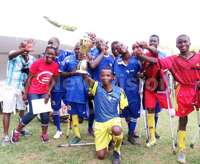 ichelle mamteker the executive director alengo foundation and mputees pose for a photo with their rophy after the game which was oganised by alengo foundation programme to commemorate the nternational orld day for ersons with isabilities which is celebrated every ecember 3 hoto by arim sozi