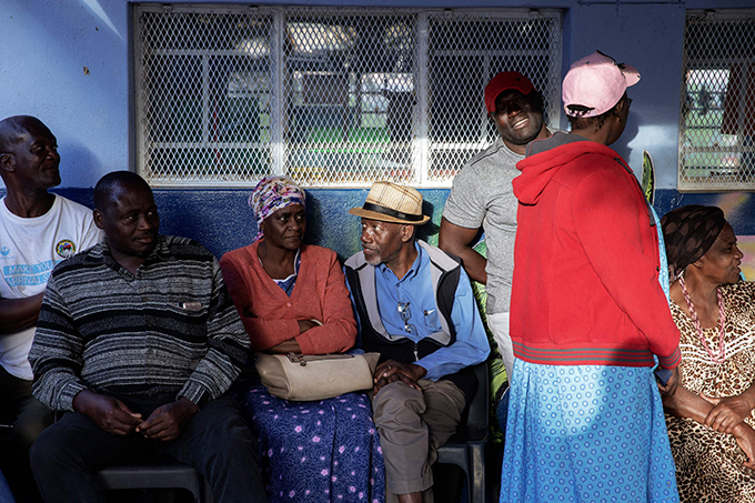amibians wait in line to access a polling station  hoto