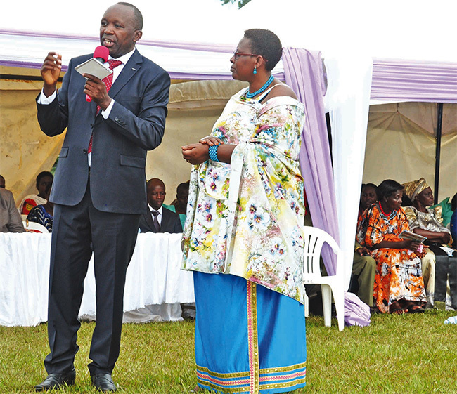 he director of the school and his wife addressing guests during one of the school functions