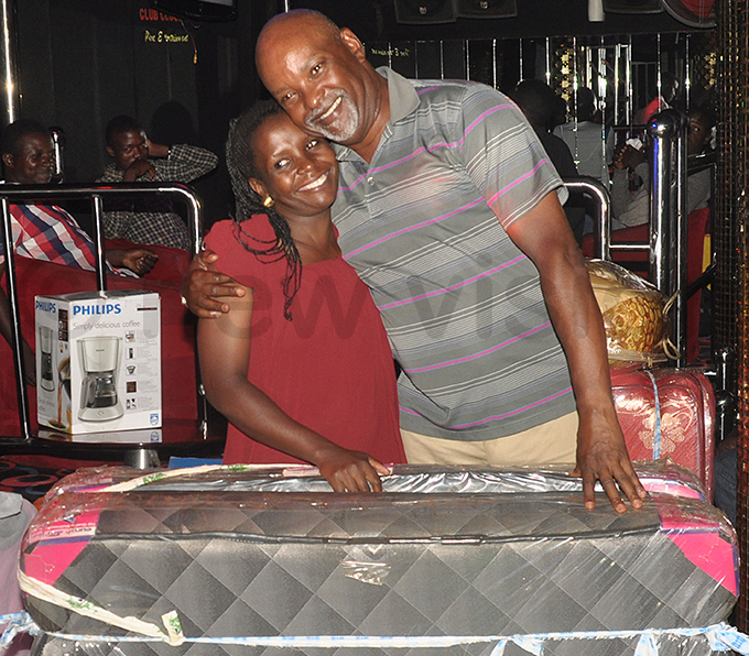 oweria amanda receives her prize from atto after she topped the ladies category hoto by ichael subuga