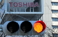 Toshiba slashes 7,000 jobs, downgrades profit outlook