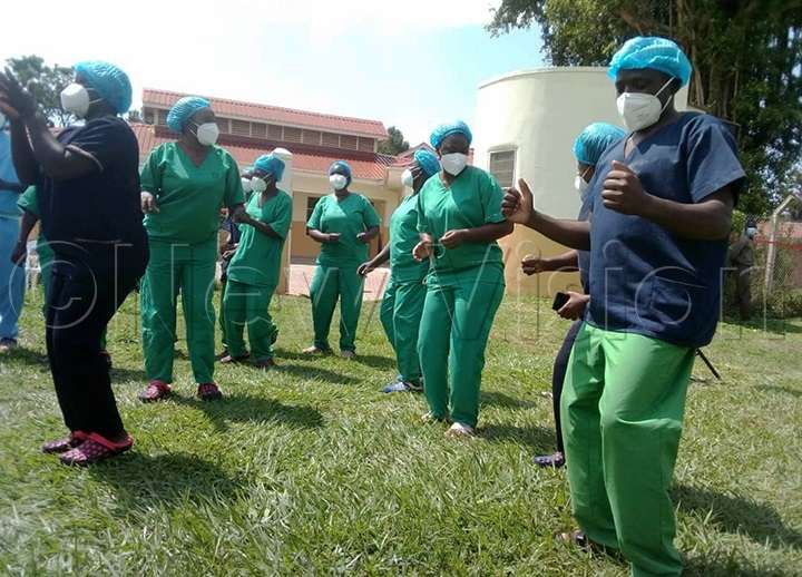 Health workers in a victory dance after 11 COVID-19 patients were discharged. (Photo by Godfrey Ojore)
