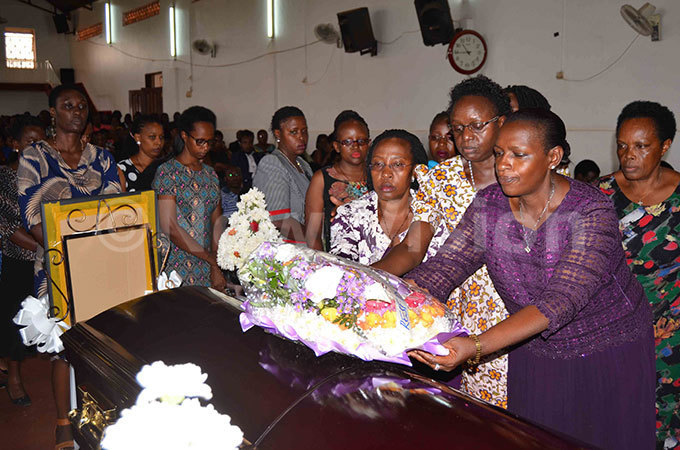 he mda omen placing a wreath on the casket containing the remains of the late eoffrey wakishumba during the funeral service hoto by athias azinga