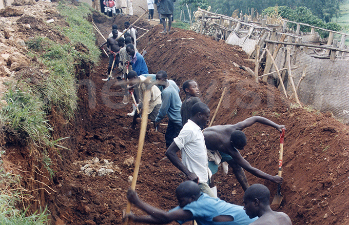 nmates who were drafted to aid the cleanup process dig a mass grave to bury the remains of the victims many of whom were burnt beyond recognition ile hoto