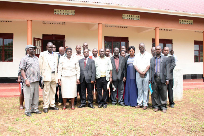 tate minister for environment lavia unaaba 3rd left and lgon region leaders flanked by representatives of  pose for photos after launching climate adaptation learning centre in ulambuli