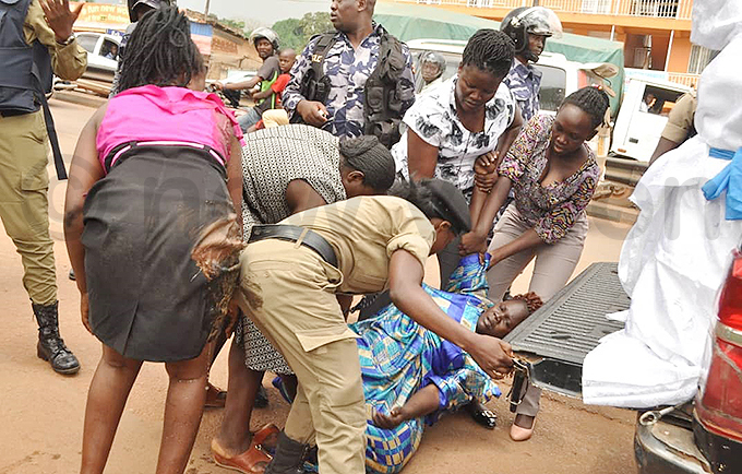 olice aided by security operatives attempt to load one of the protestors on a olice truck hoto by onsiano simbi