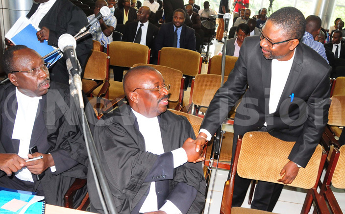 rof loka nyango greets the eputy ttorney eneral wesigwa ukutana before the court session