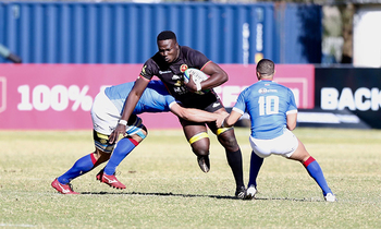 Cliven loubser and janco venter of namibia attaempt to stop uganda s aurthur mukama in windhoek 350x210