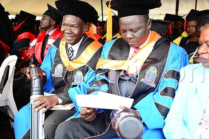 he first two h graduates of yambogo niversity hoto by imothy urungi