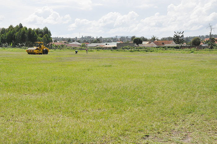 tractor seen from a distance clearing akyeka ground