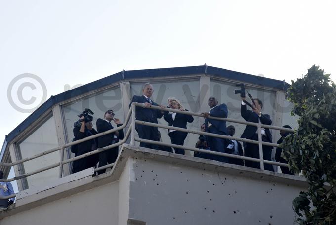 etanyahu  flanked by rime inister r uhakana ugunda  atop the tower hoto by oderick himbazwe