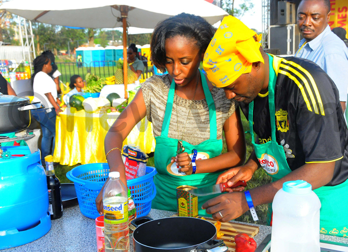 en wine and wife achael rinaitwe prepare a dish during the celebrity cookout hoto by icholas neal