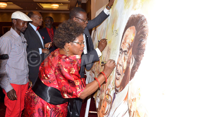 iria bote alule signing on the late pollo ilton bote painting during the memorial lecture