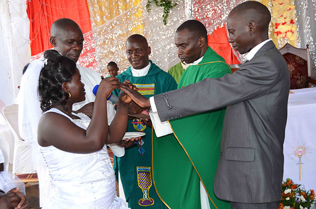 sther ampijja and ulius yeyune exchanging their marital vows before r ato emwogerere and r ames sebayigga