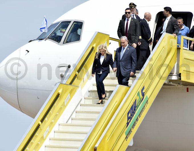 rime inister of srael enjamin etanyahu  flanked by his wife arah arrives at the ld ntebbe irport hoto by oderick himbazwe