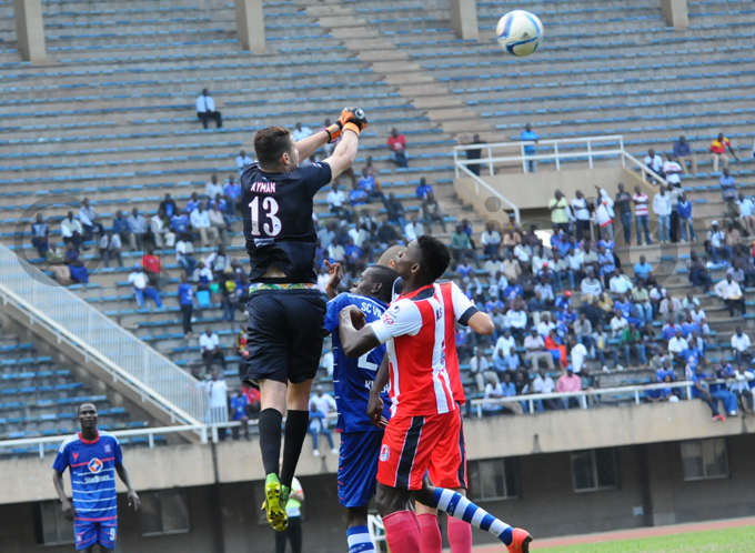 abat custodian ymane ajid punches the ball away during the match hoto by palanyi sentongo